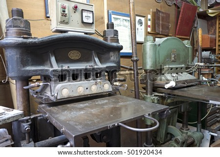 MILAN, ITALY-OCTOBER 19, 2016: vintage machines in a bindery workshop in Milan.