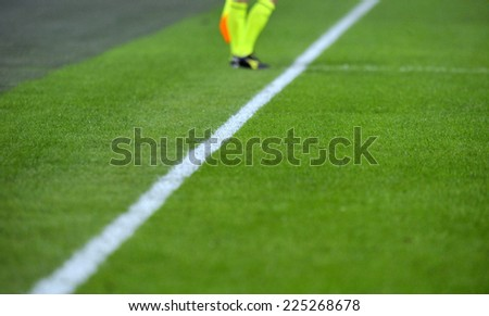 MILAN, ITALY-OCTOBER 19,2014: white line on the pitch of the san siro stadium during the Italian serie A soccer match FC Internazionale vs Napoli, in Milan. - stock photo