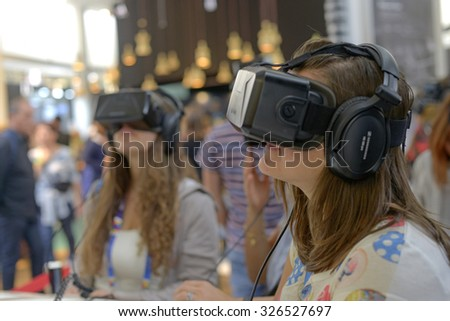 MILAN, ITALY-OCTOBER 05,2015: young girls wearing three dimensional glasses at EXPO 2015, in Milan.