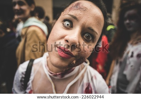 MILAN, ITALY - OCTOBER 25: Zombie parade held in Milan October 25, 2014. People took to the streets of Milan masked as zombie monsters for the next halloween holiday.