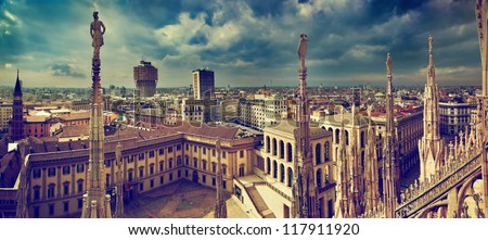 Milan, Italy panorama. View from Milan Cathedral. Royal Palace of Milan - Palazzo Realle and Velasca Tower in the background - stock photo
