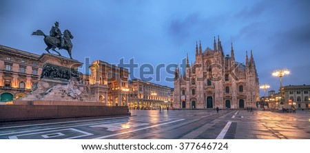 Milan, Italy: Piazza del Duomo, Cathedral Square in the sunrise. Monument to King Victor Emmanuel II. Galleria Vittorio Emanuele. - stock photo
