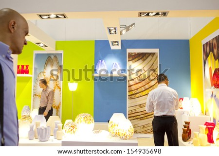 MILAN, ITALY - SEPT 12: man looking at table lamps in a booth in Macef, International Home Show Exhibition on September 12, 2013 in Milan, Italy