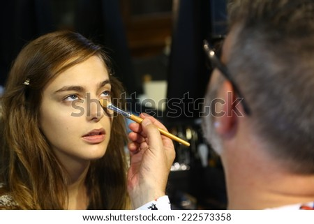 MILAN, ITALY - SEPTEMBER 20: A model gets ready backstage before the Genny fashion show as part of Milan Fashion Week Womenswear Spring-Summer 2015 on September 20, 2014 in Milan, Italy.