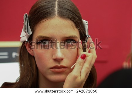 MILAN, ITALY - SEPTEMBER 17: A model getting ready backstage during the Francesco Scognamiglio show as part of Milan Fashion Week Womenswear Spring/Summer 2015 on September 17, 2014 in Milan, Italy.