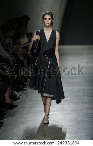 MILAN, ITALY - SEPTEMBER 20: A model walks the runway during Bottega Veneta show as a part of Milan Fashion Week Womenswear Spring/Summer 2015 on September 20, 2014 in Milan, Italy