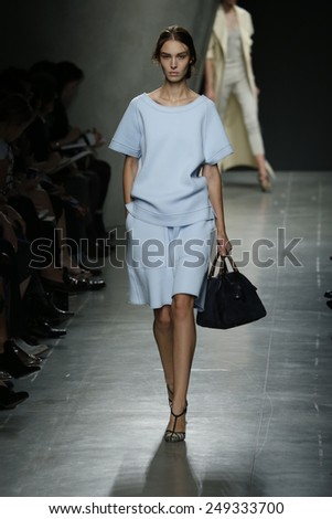 MILAN, ITALY - SEPTEMBER 20: A model walks the runway during Bottega Veneta show as a part of Milan Fashion Week Womenswear Spring/Summer 2015 on September 20, 2014 in Milan, Italy - stock photo