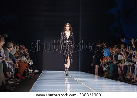 Milan, Italy - 24 September 2015: A model walks the runway during the Anteprima fashion show as part of Milan Fashion Week Spring/Summer 2016 - stock photo