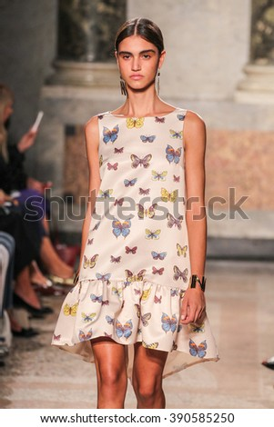 MILAN, ITALY - SEPTEMBER 24: A model walks the runway during the Blugirl show as a part of Milan Fashion Week Spring/Summer 2016 on September 24, 2015 in Milan, Italy. - stock photo