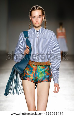MILAN, ITALY - SEPTEMBER 24: A model walks the runway during the Cristiano Burani fashion show as part of Milan Fashion Week Spring/Summer 2016 on September 24, 2015 in Milan, Italy.  - stock photo