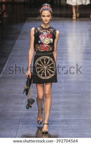 MILAN, ITALY - SEPTEMBER 27: A model walks the runway during the Dolce and Gabbana show as a part of Milan Fashion Week Spring/Summer 2016 on September 27, 2015 in Milan, Italy.  - stock photo