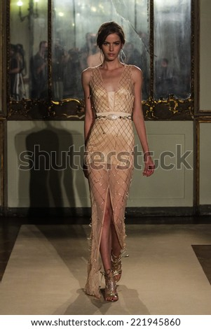 MILAN, ITALY - SEPTEMBER 20: A model walks the runway during the Elisabetta Franchi show as part of Milan Fashion Week Womenswear Spring- Summer 2015 on September 20, 2014 in Milan, Italy. - stock photo