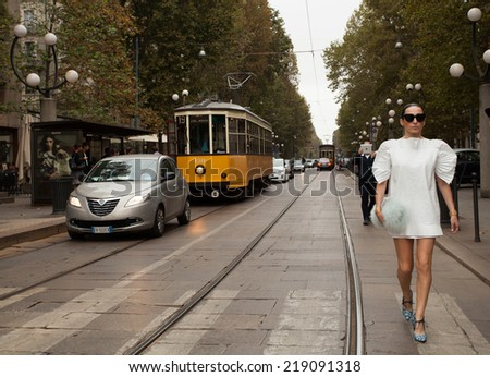 MILAN, ITALY - SEPTEMBER 20: A yung fashion and sexy woman walking in the streets of Milan. Outside Cavalli fashion shows building for Milan Women's Fashion Week on SEPTEMBER 20, 2014 in Milan. - stock photo