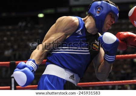 MILAN, ITALY-SEPTEMBER 08, 2009: amateur boxers Sosa vs Subacius during a boxe match of the World Boxing Championship, in Milan.