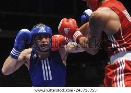 MILAN, ITALY-SEPTEMBER 08, 2009: amateur boxers Usyk vs Simmons during a boxe match of the World Boxing Championship, in Milan.