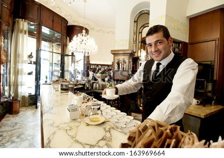 MILAN, ITALY - SEPTEMBER 17: barman of the historical Taveggia cafeteria , September 17, 2008 in Milan, Italy. - stock photo