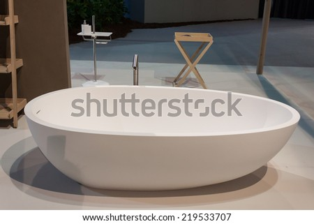 MILAN, ITALY - SEPTEMBER 13: Bath tub on display at HOMI, home international show and point of reference for all those in the sector of interior design on SEPTEMBER 13, 2014 in Milan.