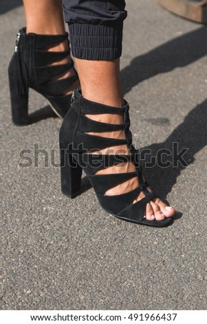 MILAN, ITALY - SEPTEMBER 23, 2016: Detail of shoes outside Krizia fashion show building during Milan Women Fashion Week SS17.