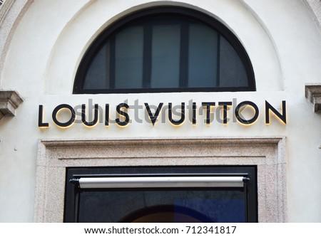 MILAN, ITALY - SEPTEMBER 7, 2017: Facade with sign of Louis Vuitton store in via Monte Napoleone, Milan, Italy