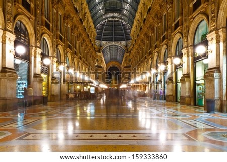 MILAN, ITALY - SEPTEMBER 11: Galleria Vittorio Emanuele II on September 11, 2013 in Milan. It's one of the world's oldest shopping malls, designed and built by Giuseppe Mengoni between 1865 and 1877. - stock photo