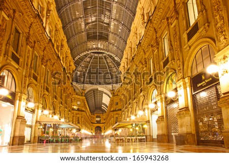 MILAN, ITALY - SEPTEMBER 2: Galleria Vittorio Emanuele II on September 2, 2012 in Milan. It's one of the world's oldest shopping malls, designed and built by Giuseppe Mengoni between 1865 and 1877.  - stock photo