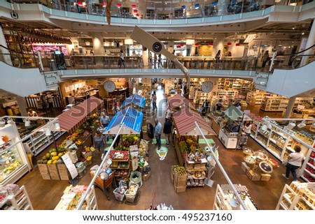 MILAN, ITALY - SEPTEMBER 27, 2016: Inside Eataly store. Eataly is a high-end Italian food market/mall chain founded by Oscar Farinetti in 2004.