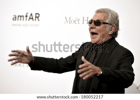 MILAN, ITALY-SEPTEMBER 22, 2012: Italian stylist Roberto Cavalli, attends the red carpet on a charity event for AmFar, the Foundation for AIDS Research, during the Fashion Week in Milan.