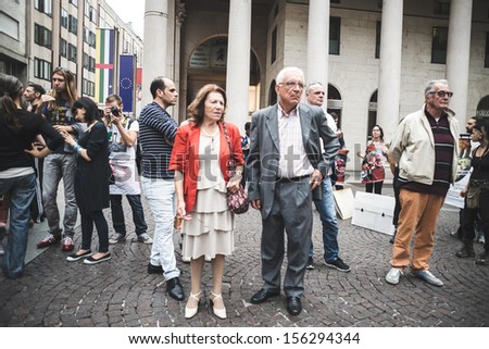 MILAN, ITALY - SEPTEMBER 26: 269 Life  manifestation on September 26, 2013. People shocked looking as 269 activists performance of fake corpses