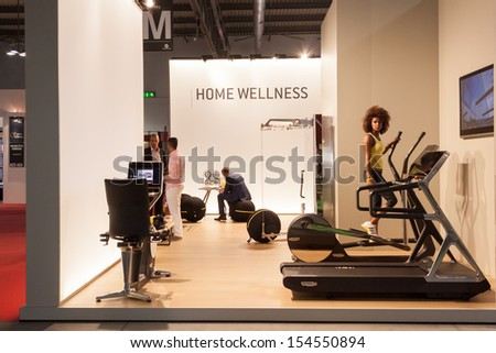 MILAN, ITALY - SEPTEMBER, 12: Macef, home international show in Milan, SEPTEMBER 12, 2013. Technogym fitness stand at Macef home show, point of reference for all those in the sector of interior design - stock photo