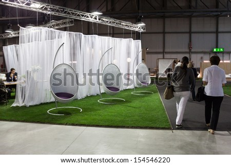MILAN, ITALY - SEPTEMBER, 12: Macef, home international show in Milan, SEPTEMBER 12, 2013. People visit stands at Macef home show, point of reference for all those in the sector of interior design - stock photo