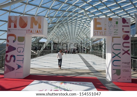 MILAN, ITALY - SEPTEMBER, 12: Macef, home international show in Milan, SEPTEMBER 12, 2013. People walk to the entrance of Macef international home show