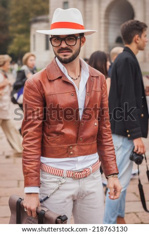 MILAN, ITALY - SEPTEMBER 20: Man poses outside Cavalli fashion shows building for Milan Women's Fashion Week on SEPTEMBER 20, 2014 in Milan.