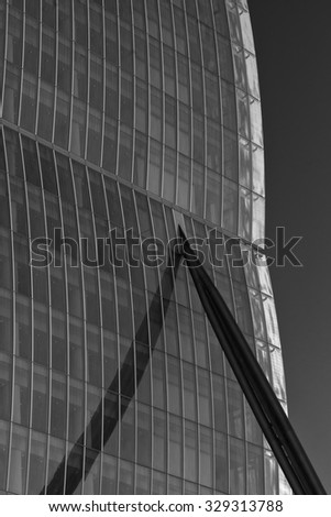MILAN, ITALY - SEPTEMBER 20, 2015: Modern building in Milan (Lombardy, Italy): Citylife. Black and white