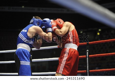 MILAN, ITALY-SEPTEMBER 05, 2009: non professional boxe match zhang  vs milevski of the boxe amateur world championship, in Milan