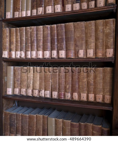 MILAN, ITALY-SEPTEMBER 26, 2016: old vintage books dispalyed at the National Braidense public library, inside the historical Brera palace in Milan.