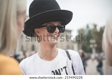 MILAN, ITALY - SEPTEMBER 20: People during Milan Fashion week, Italy on September, 20 2014. Eccentric and fashionable people outside city during Milan fashion week wait for models and famous people