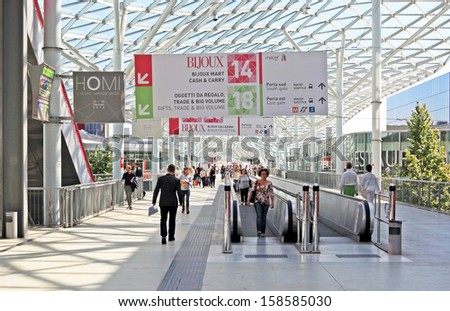 MILAN, ITALY - SEPTEMBER 13: People enter home interiors design exposition at Macef, International Home Show Exhibition on September, 13 2013 in Milan, Italy.
