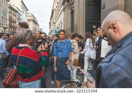 MILAN, ITALY - SEPTEMBER 27: People gather outside Trussardi fashion show building for Milan Women's Fashion Week on SEPTEMBER 27, 2015  in Milan. - stock photo