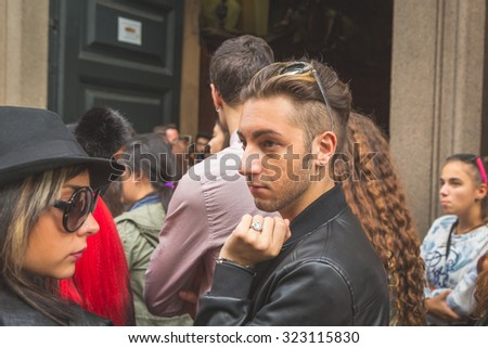 MILAN, ITALY - SEPTEMBER 27: People gather outside Trussardi fashion show building for Milan Women's Fashion Week on SEPTEMBER 27, 2015  in Milan.