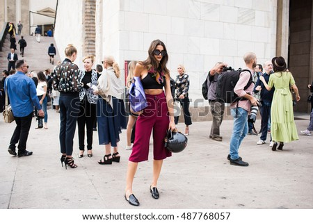 MILAN, ITALY - SEPTEMBER 22, 2016: People in the street attending fashion shows during Milan Fashion Week Woman spring/summer 2017