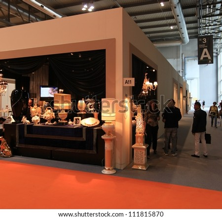 MILAN, ITALY - SEPTEMBER 09: People visit architecture and interior design exposition at Macef, International Home Show Exhibition on September 09, 2011 in Milan, Italy.