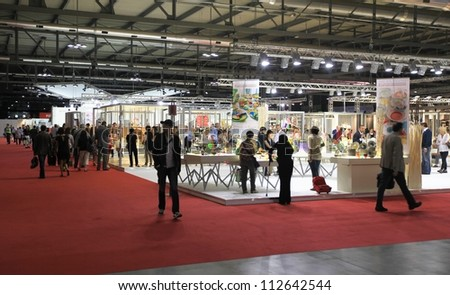MILAN, ITALY - SEPTEMBER 06: People visit architecture interiors design and home decoration exposition at Macef, International Home Show Exhibition on September 06, 2012 in Milan, Italy. - stock photo