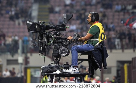 MILAN, ITALY-SEPTEMBER 20, 2014: television cameraman at the San Siro stadium, during the professional serie A soccer match AC Milan vs Juventus, in Milan. - stock photo