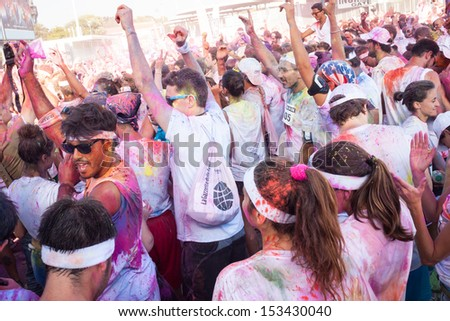 MILAN, ITALY - SEPTEMBER, 7: The Color Run event in Milan September 7, 2013. Thousands of people take part in the funniest and most colorful urban running ever.