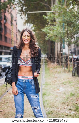 MILAN, ITALY - SEPTEMBER 17: Woman poses outside Gucci fashion shows building for Milan Women's Fashion Week on SEPTEMBER 17, 2014 in Milan.