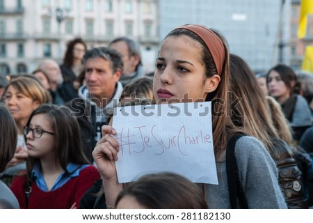 Milan, January 10, 2015 - A thoughtful girl holding a sheet with the words 'I am Charlie' as a sign of solidarity for the victims of terrorism that has hit France - stock photo