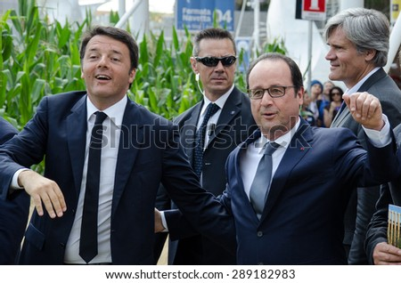 MILAN, JUNE 21, 2015: Italian Prime Minister Matteo Renzi welcomes French President, Francois Hollande at Expo Milan 2015 on the occasion of the French National Day.