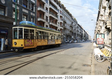 Milan, Lombardy, Italy - February, 2015: Characteristic tram on the streets of Milan waiting for the event internatioal expo 2015