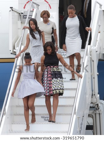 MILAN MALPENSA - JUNE 16, 2015: The first lady Michelle Obama lands in Milan to visit Expo 2015, with daughters Malia and Sasha, and her mother Marian Robinson. - stock photo