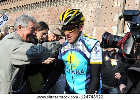 MILAN - 21 MARCH: cyclist Lance Armstrong of Team Astana waves prior the start of the 100th Milan San Remo classic cycling race in Milan, Italy - 21 March, 2009 - stock photo